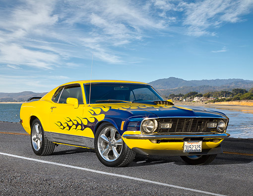 MST 01 RK1652 01 © Kimball Stock 1970 Ford Mustang Mach 1 Yellow With Blue Flames 3/4 Front View On Road By Beach