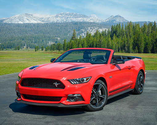 MST 01 RK1684 01 © Kimball Stock 2016 Ford Mustang GT Convertible Red 3/4 Front View In Forest Meadow