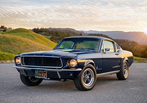 MST 01 RK1694 01 © Kimball Stock 1967 Ford Mustang Night Mist Blue 3/4 Front View By Grassy Hills At Sunset