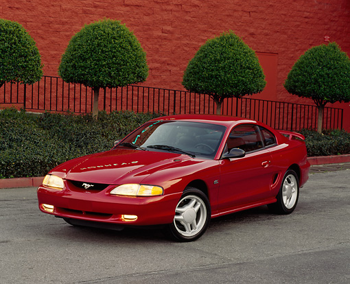 MST 01 RK0027 04 © Kimball Stock 1994 Ford Mustang GT Coupe Red 3/4 Front On Pavement