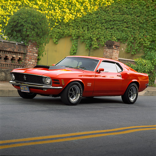 MST 01 RK0039 02 © Kimball Stock 1970 Ford Mustang Boss 429 Red Side 3/4 View On Road
