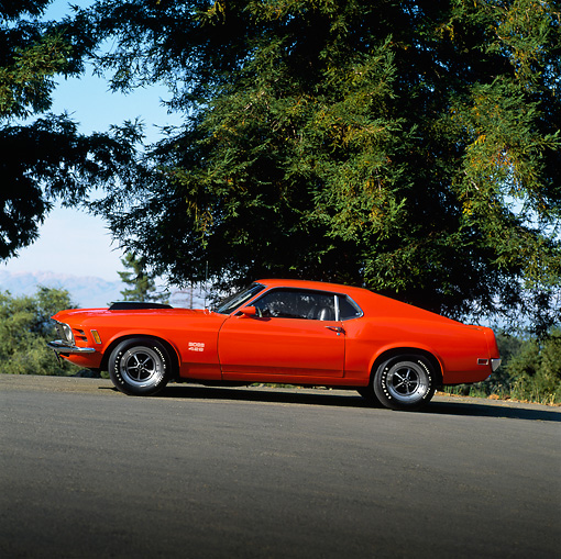 MST 01 RK0046 04 © Kimball Stock 1970 Ford Mustang Boss 429 Red Profile View On Pavement