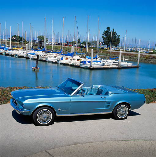 MST 01 RK0107 03 © Kimball Stock 1967 Ford Mustang Convertible Aqua Overhead 3/4 Side View On Pavement