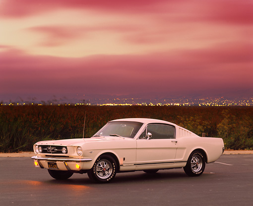 MST 01 RK0121 07 © Kimball Stock 1965 Ford Mustang GT Fastback White 3/4 Side View On Pavement By Field Filtered