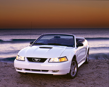 MST 01 RK0168 02 © Kimball Stock 1999 Ford Mustang GT Convertible White 3/4 Front View On Sand By Ocean