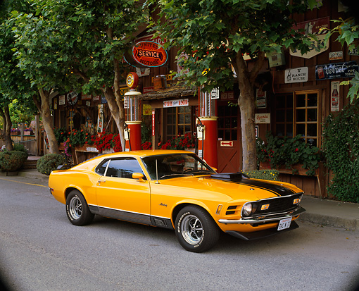 MST 01 RK0172 08 © Kimball Stock 1970 Mustang Mach 1 Grabber Orange 3/4 Front View On Pavement