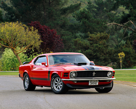 MST 01 RK0191 03 © Kimball Stock 1970 Ford Mustang Boss 302 Calypso Coral 3/4 Front View On Pavement By Trees