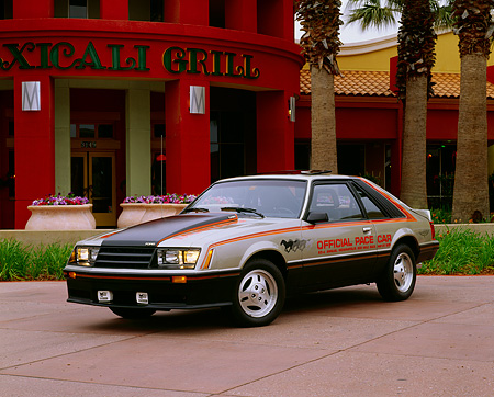 MST 01 RK0198 01 © Kimball Stock 1979 Ford Mustang Pace Car Front 3/4 View On Cement In Front Of Restaurant Headlights On