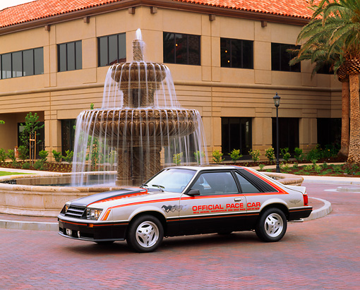 MST 01 RK0203 01 © Kimball Stock 1979 Ford Mustang Pace Car Front 3/4 View By Fountain And Building