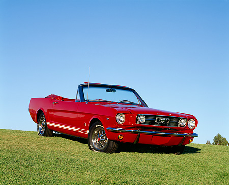 MST 01 RK0239 01 © Kimball Stock 1966 Ford Mustang Convertible Red 3/4 Front View On Grass Hill Blue Sky