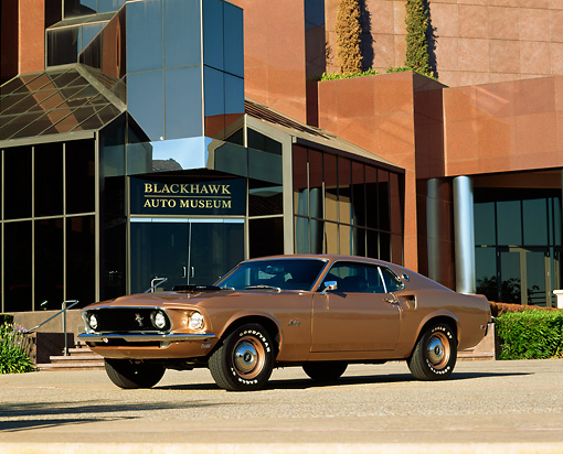 MST 01 RK0254 01 © Kimball Stock 1969 Ford Mustang Copper Low Side 3/4 View On Pavement