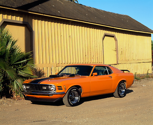 MST 01 RK0306 01 © Kimball Stock 1970 Ford Mustang Mach 1 Grabber Orange 3/4 Front View On Dirt
