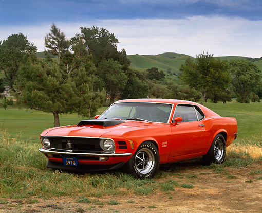 MST 01 RK0362 09 © Kimball Stock 1970 Ford Mustang Boss 429 Orange Side 3/4 View On Dirt