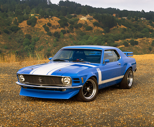 MST 01 RK0446 04 © Kimball Stock 1970 Ford Mustang Trans Am Coupe Blue 3/4 Front View On Dirt By Hills