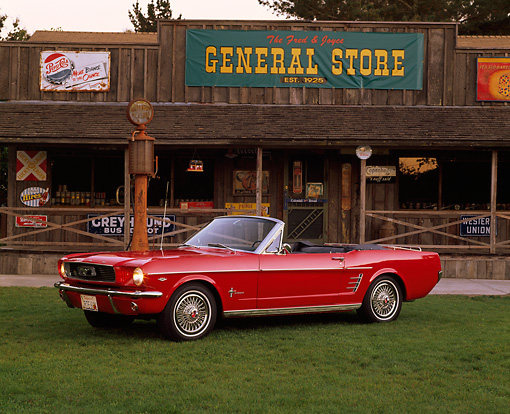 MST 01 RK0488 03 © Kimball Stock 1966 Ford Mustang Convertible Red 3/4 Side View On Grass