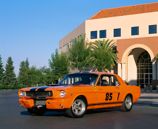MST 01 RK0510 01 © Kimball Stock 1966 Mustang Coupe Orange With Black Stripe Low 3/4 Side View On Pavement
