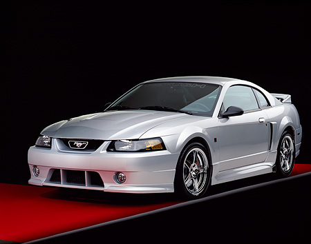 MST 01 RK0556 03 © Kimball Stock 2001 Roush Mustang Stage 3 Silver 3/4 Front View On Red Floor Gray Line Studio