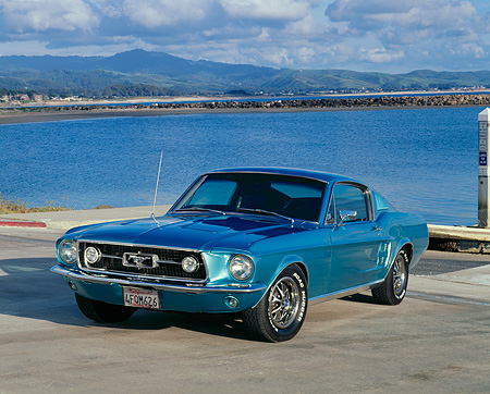 MST 01 RK0564 01 © Kimball Stock 1967 Ford Mustang Fastback Aqua 3/4 Front View On Pavement By Water