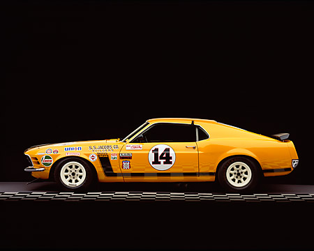 MST 01 RK0611 01 © Kimball Stock 1970 Ford Mustang Boss 302 Trans Am Race Car Orange Profile View Studio