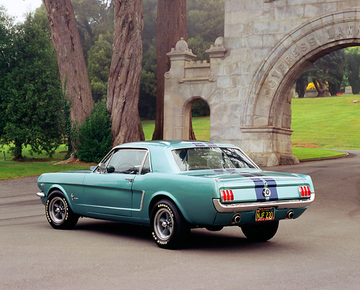 MST 01 RK0674 01 © Kimball Stock 1965 Ford Mustang Green Black Stripes 3/4 Rear View On Pavement By Arch