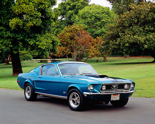 MST 01 RK0692 03 © Kimball Stock 1968 1/2 Ford Mustang GT Fastback Aqua 3/4 Front View On Pavement By Grass And Trees