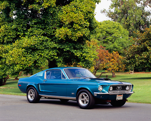 MST 01 RK0695 02 © Kimball Stock 1968 1/2 Ford Mustang GT Fastback Aqua 3/4 Front View By Grass And Trees