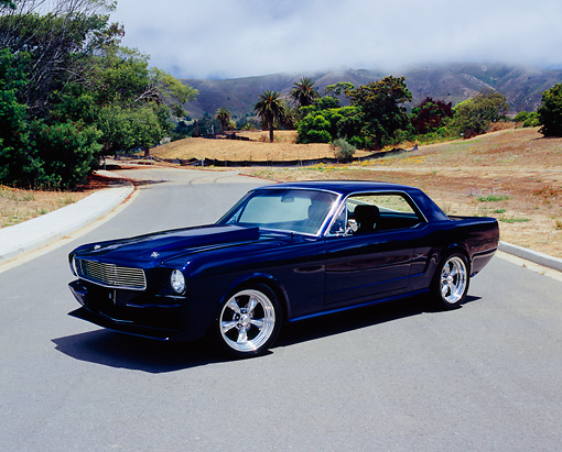 MST 01 RK0699 01 © Kimball Stock 1966 Ford Mustang Custom Blue 3/4 Front View By Trees Dry Grass Hills