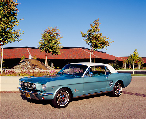 MST 01 RK0707 03 © Kimball Stock 1966 Ford Mustang Turquoise White Top 3/4 Front View On Pavement By Building