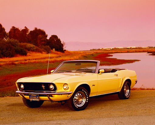 MST 01 RK0721 03 © Kimball Stock 1969 Ford Mustang Convertible Yellow 3/4 Front View On Pavement By Water Filtered
