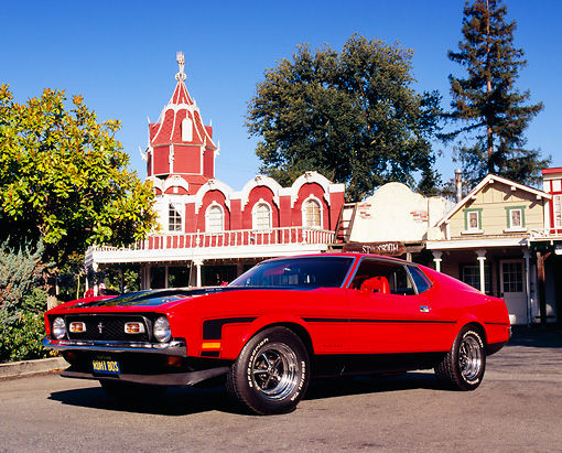 MST 01 RK0732 03 © Kimball Stock 1971 Ford Mustang Boss 351 Red Black Stripes Low 3/4 Front View On Pavement By Village