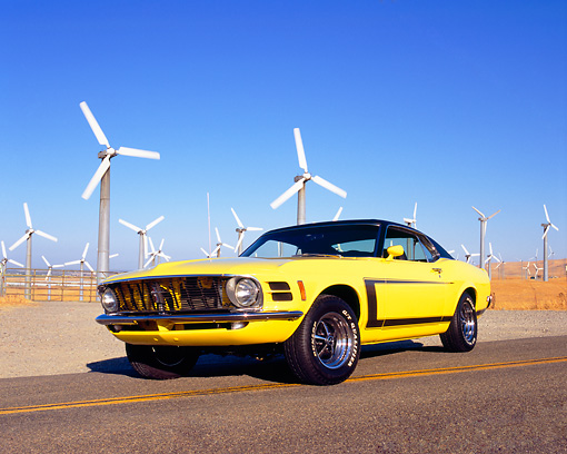 MST 01 RK0738 02 © Kimball Stock 1970 Ford Mustang Yellow And Black Low 3/4 Front View On Road By Wind Farm