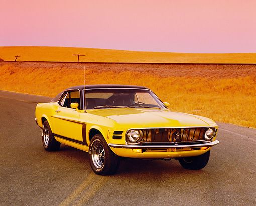 MST 01 RK0743 03 © Kimball Stock 1970 Ford Mustang Yellow And Black 3/4 Front View On Road By Dry Grass Filtered