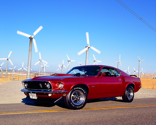 MST 01 RK0751 01 © Kimball Stock 1969 Ford Mustang Burgundy Low 3/4 Front View On Road By Wind Farm
