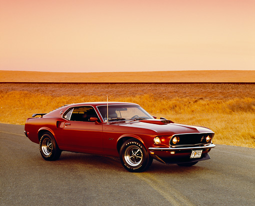 MST 01 RK0759 01 © Kimball Stock 1969 Ford Mustang Burgundy 3/4 Front View On Road By Dry Grass Hills Filtered