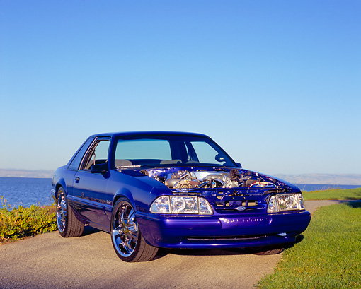 MST 01 RK0777 06 © Kimball Stock 1987 Ford Mustang Blue Purple 3/4 Front View On Pavement By Water
