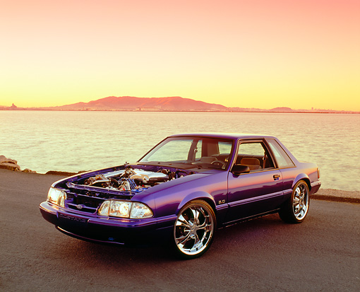 MST 01 RK0779 03 © Kimball Stock 1987 Ford Mustang Blue Purple 3/4 Front View On Pavement By Water