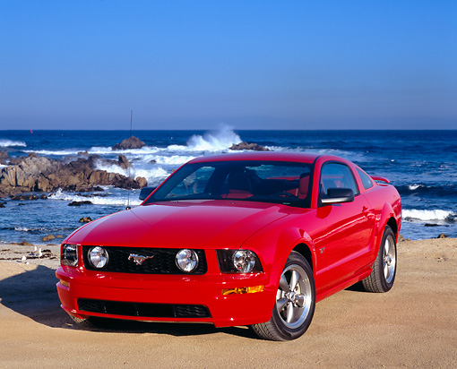 MST 01 RK0802 04 © Kimball Stock 2005 Ford Mustang GT Coupe Red 3/4 Front View On Pavement By Ocean