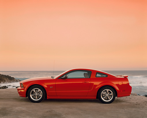 MST 01 RK0814 02 © Kimball Stock 2005 Ford Mustang GT Coupe Red Profile On Sand By Ocean Filtered