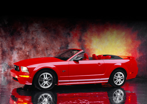 MST 01 RK0838 03 © Kimball Stock 2005 Ford Mustang GT Convertible Red 3/4 Side View On Mylar Floor Sunburst Background