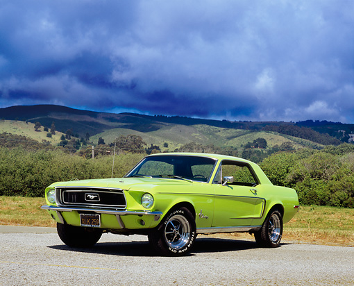 MST 01 RK0882 04 © Kimball Stock 1968 Ford Mustang Grabber Lime 3/4 Front View On Pavement Dark Clouds