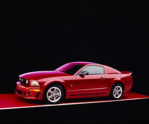 MST 01 RK0888 10 © Kimball Stock 2005 Ford Roush Mustang Red Side 3/4 View On Red Floor Purple Lighting Studio