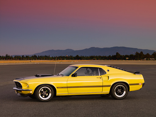 MST 01 RK1008 01 © Kimball Stock 1969 Ford Mustang Mach 1 Yellow 3/4 Side View On Pavement