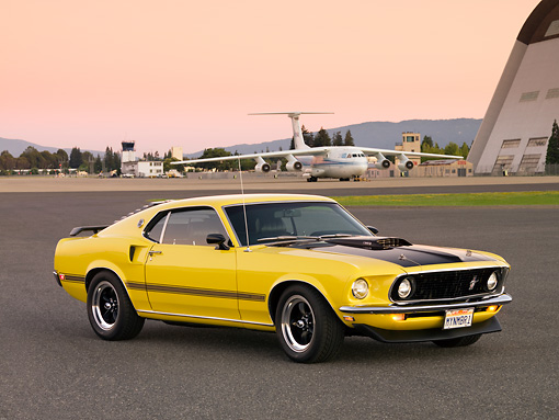 MST 01 RK1011 01 © Kimball Stock 1969 Ford Mustang Mach 1 Yellow 3/4 Side View On Pavement