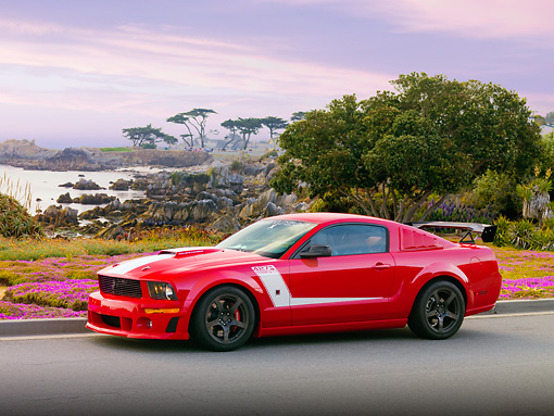 MST 01 RK1041 01 © Kimball Stock 2008 Roush Ford Mustang 427R Trak Pak Red 3/4 Front View By Trees Water