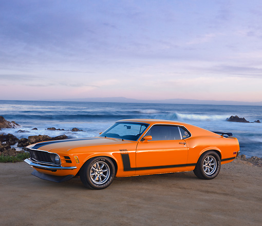 MST 01 RK1106 01 © Kimball Stock 1970 Ford Boss 302 Mustang Orange With Black Stripe 3/4 Front View By Ocean