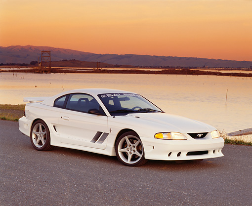 MST 02 RK0017 02 © Kimball Stock 1994 Ford Saleen Mustang S351 White 3/4 Side View On Pavement By Water At Dusk