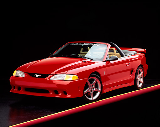 MST 02 RK0026 05 © Kimball Stock 1995 Ford Saleen Mustang S351 Convertible Red 3/4 Front View On Red And Yellow Lines Studio