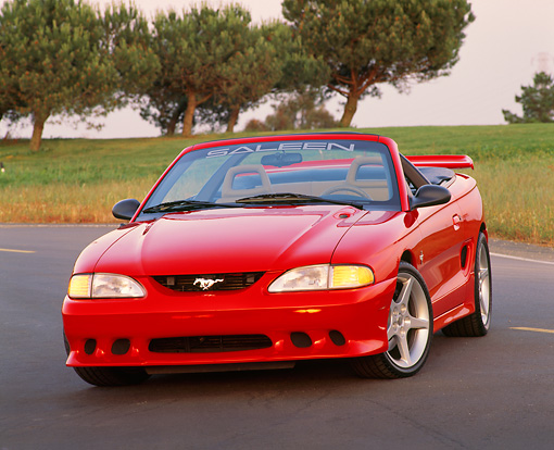 MST 02 RK0027 02 © Kimball Stock 1995 Ford Saleen Mustang S351 Convertible Red 3/4 Front View On Pavement By Grass And Trees
