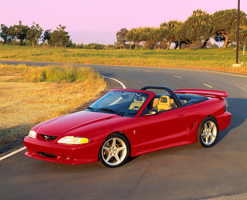 MST 02 RK0036 03 © Kimball Stock 1995 Ford Mustang Saleen S351 Convertible Overhead 3/4 Front View On Road