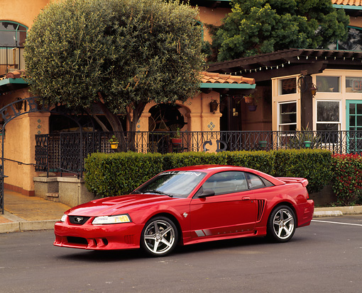 MST 02 RK0039 01 © Kimball Stock 1999 Ford Saleen Mustang Red Side 3/4 View On Pavement